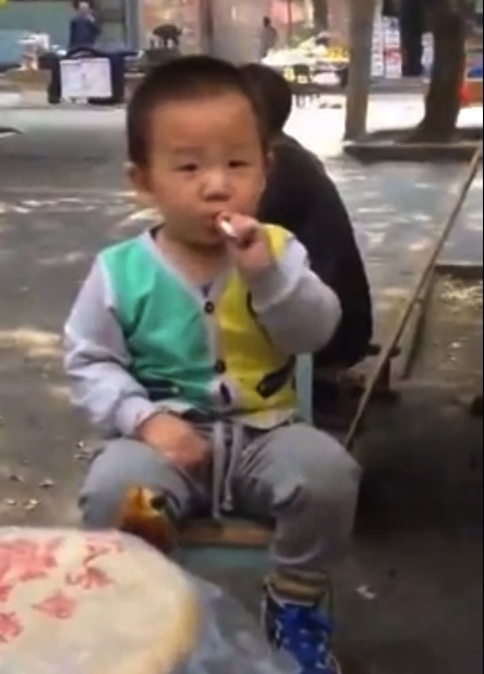 Toddler in China videotaped smoking in the streets