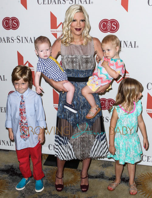 Tori Spelling (C) and children (L-R) Liam Aaron McDermott, Finn Davey McDermott, Hattie Margaret McDermott and Stella Doreen McDermott attend 'The Helping Hand of Los Angeles'' annual Mother's Day luncheon at the Beverly Hills Hotel in Los Angeles
