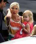 Tori Spelling carries her daughter Hattie while out shopping