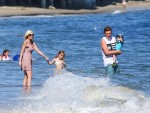 Tori Spelling with Stella, Finn and Jack at the beach in Malibu