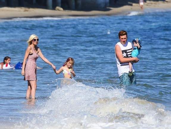 Tori Spelling with Stella, Finn and Jack at the beach in Malibu