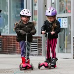 Twins Tabitha (Loretta) and Marion Broderick scoot home from school