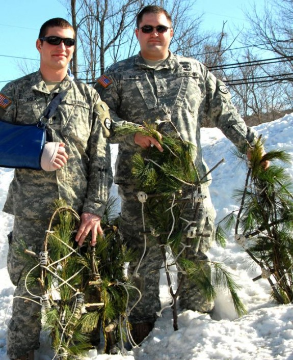 Two medical officers, Staff Sgt. Harry F. Accor III and Spc. Derek C. Folk