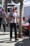 Will Kopelman at the farmer's market with daughter Olive