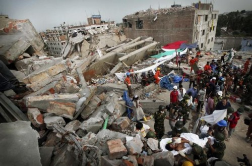 Workers search for survivor at the  Garment Building collapse in Bangladesh