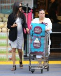 Zoe Saldana shows off a rounded tummy while out shopping