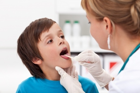doctor checking child