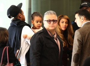 jay Z and Beyonce board a Train in Paris with their daughter Blue