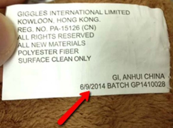 label on recalled Giggles International Animated Sing-Along Monkey toy