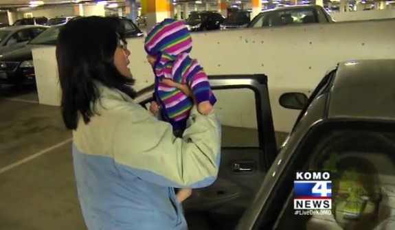 mom grabs her Forgotten baby from the car