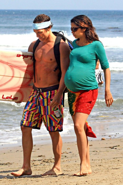 **EXCLUSIVE**RESTRICTIONS APPLY: Matthew McConaughey is met by his heavily pregnant girlfriend Camila Alves and a refreshing beer after surfing in Malibu on Independence Day